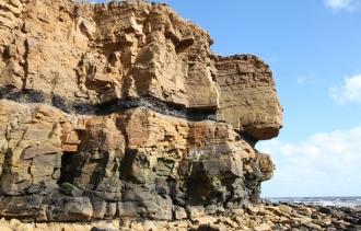 sandstone cliffs with seam